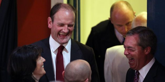 Douglas Carswell, with his wife Clementine share a joke with UKIP party leader Nigel Farage as they wait for the results of the Clacton constituency parliamentary by-election