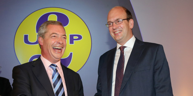 DONCASTER, ENGLAND - SEPTEMBER 27:  Conservative MP Mark Reckless is welcomed to UKIP by party leader Nigel Farage after the tory MP announced he was defecting on the second day of the UKIP (UK Independence Party) party conference at Doncaster Racecourse on September 27, 2014 in Doncaster, England.  Party leader Nigel Farage declared that in the run up to next years general election UKIP will be targeting voters in Conservative and Labour heartlands.  (Photo by Christopher Furlong/Getty Images)