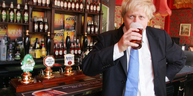 London Mayor Boris Johnson enjoys a pint of Greene King's Abbot Ale at the King's Arms pub on Tooley St in London, to celebrate National Cask Ale Week and to urge people to support their local pub.