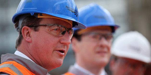 MANCHESTER, ENGLAND - JUNE 23:  British Prime Minister David Cameron (L) and British Chancellor George Osborne tour building works at Manchester's Victoria Railway Station which is being upgraded on June 23, 2014 in Manchester, England. Chancellor George Osborne earlier spoke of a proposed HS3 high-speed rail link between Manchester and Leeds that would help build a 'northern global powerhouse' linking cities across the North of England.  (Photo by Christopher Furlong - WPA Pool /Getty Images)