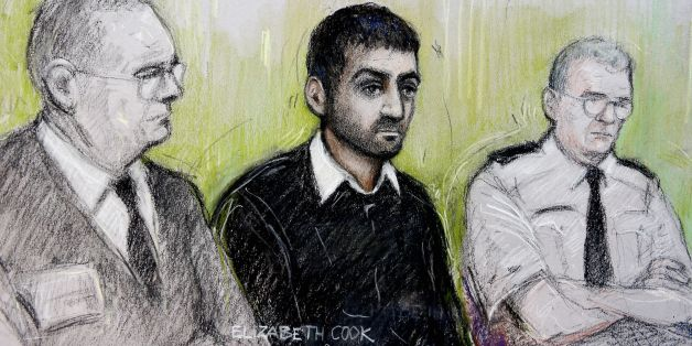 Court artist sketch by Elizabeth Cook of Erol Incedal (centre),formerly known in the case as AB, appearing at the Old Bailey accused of preparing acts of terrorism and possessing a document entitled Bomb Making, the case is the first major terror trial in the UK to be heard almost entirely in secret.