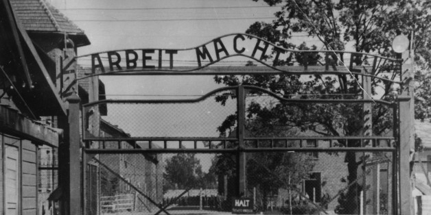 "FILE - This undated file image shows the main gate of the Nazi concentration camp Auschwitz I, near Oswiecim , Poland, which was liberated by the Russians in January 1945. Writing at the gate reads: ""Arbeit macht frei"" (Work makes free - or work liberates). German prosecutors say theyve charged a 93-year-old man with 300,000 counts of accessory to murder for serving as a guard at the Nazis Auschwitz death camp. The charges against Oskar Groening come as part of a nationwide push against former A"