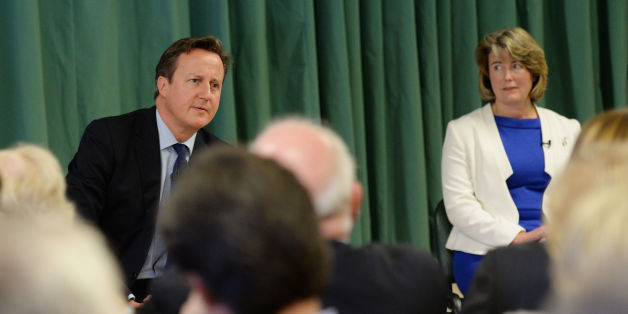 Prime Minister David Cameron at Wainscott Memorial Hall in Rochester with one of the Conservative Party's two applicants, Anna Firth (white jacket), for the nomination of candidate in upcoming Rochester and Strood by-election forced by the defection of Mark Reckless to UKIP last month.