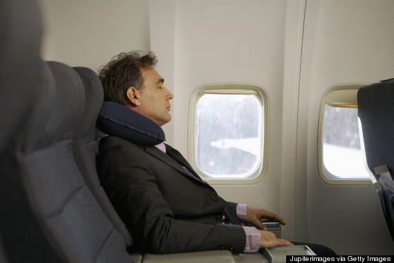 man sleeping on aeroplane