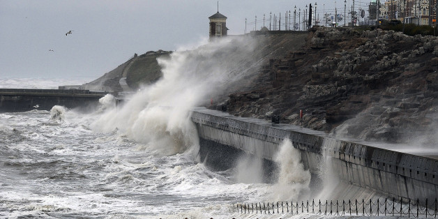 Large waves hit the seafront at Blackpool, as the remnants of Hurricane Gonzalo blew into Britain, causing rush-hour travel misery for road, rail and air travellers.
