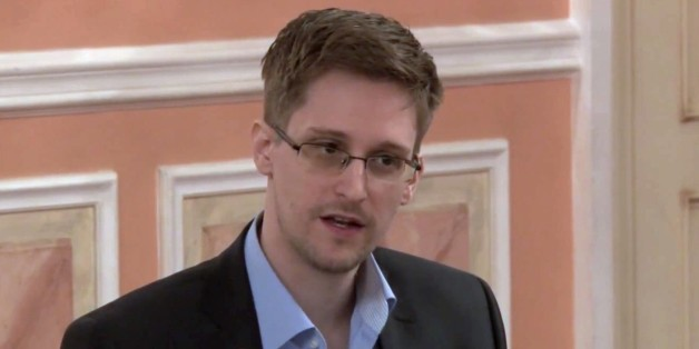 In this image made from video released by WikiLeaks on Friday, Oct. 11, 2013, former National Security Agency systems analyst Edward Snowden speaks during a presentation ceremony for the Sam Adams Award in Moscow, Russia. Should Snowden ever return to the U.S., he would face criminal charges for leaking information about NSA surveillance programs. But legal experts say a trial could expose more classified information as his lawyers try to build a case in an open court that the operations he expo