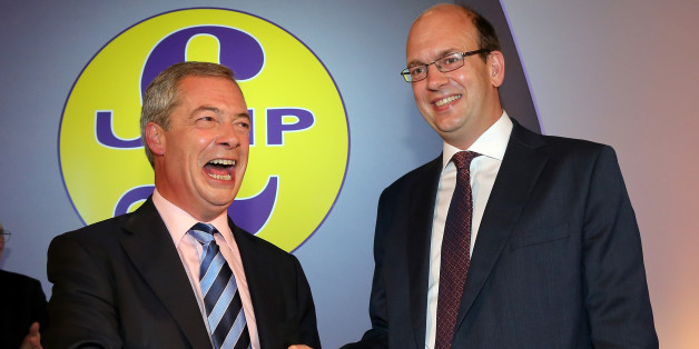 Conservative MP Mark Reckless (R) is welcomed to UKIP by party leader Nigel Farage after the tory MP announced he was defecting on the second day of the UKIP (UK Independence Party) party conference at Doncaster Racecourse on September 27, 2014 in Doncaster, England.  Party leader Nigel Farage declared that in the run up to next years general election UKIP will be targeting voters in Conservative and Labour heartlands.  (Photo by Christopher Furlong/Getty Images)