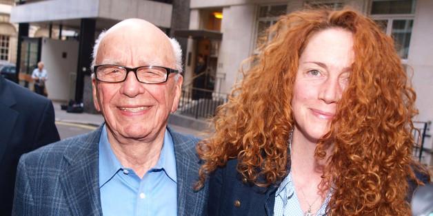 News International chief executive Rebekah Brooks and Rupert Murdoch are seen outside Mr Murdochs London flat.