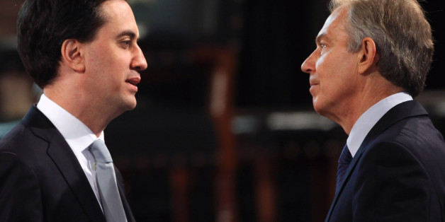 Leader of the Labour party Ed Miliband and former British Prime Minister Tony Blair speak before Queen Elizabeth II addressed both Houses of Parliament as part of her visit to mark her Diamond Jubilee year.