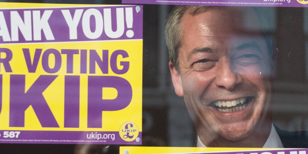 UKIP leader Nigel Farage looks out of the window of the UKIP campaign headquarters in Clacton, after last night's by-election victory.