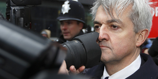 Former British energy minister Chris Huhne (R) comes into contact with a photographers lens as he arrives at Southwark Crown Court in London, on March 11, 2013. Huhne and his ex-wife Vicky Pryce are due to be sentenced later Monday for perverting the course of justice over speeding points a decade ago.   AFP PHOTO / JUSTIN TALLIS        (Photo credit should read JUSTIN TALLIS/AFP/Getty Images)