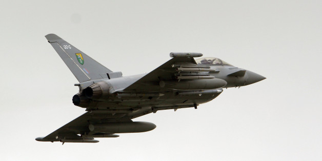 A British Royal Air Force (RAF) Typhoon jet fighter departs Gioia del Colle air base, Italy, Tuesday, March 22, 2011.