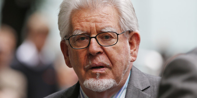 Veteran entertainer Rolf Harris leaves the Southwark Crown Court in London, Monday, June 30, 2014.  A jury Monday found Australian-born Harris guilty of 12 counts of indecent assault.The 84-year-old was convicted of indecent assault on four victims aged 19 or under between 1968 and 1986.  (AP Photo/Lefteris Pitarakis)