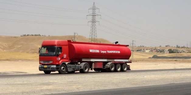 Oil tankers transport petrol sold by IS (Islamic State) to Kurdish business men on July 12, 2014, in Iraq's disputed northern city of Kirkuk. Iraq's Kurdish region claimed disputed northern oilfields in another blow to efforts to forge a united front against a jihadist-led onslaught, as twin bombings killed 28 people. AFP PHOTO/MARWAN IBRAHIM        (Photo credit should read MARWAN IBRAHIM/AFP/Getty Images)