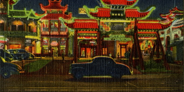 UNITED STATES - CIRCA 1943:  Postcard view of Chinatown at night showing the building lit by neon. Vintage automobiles are on the street.  (Photo by Lake County Museum/Getty Images)