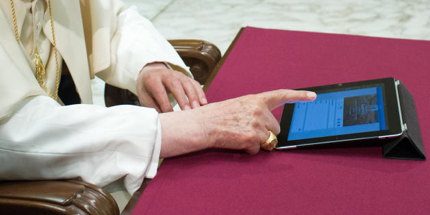 "In this photo provided by the Vatican newspaper L'Osservatore Romano, Pope Benedict XVI pushes a button on a tablet at the Vatican, Wednesday, Dec. 12, 2012. In perhaps the most drawn out Twitter launch ever, Pope Benedict XVI pushed the button on a tablet brought to him at the end of his general audience Wednesday. It read: ""Dear friends, I am pleased to get in touch with you through Twitter. Thank you for your generous response. I bless all of you from my heart.""Later in the day he was to resp"