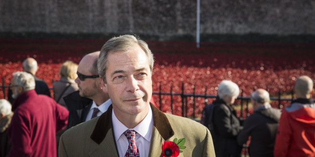 LONDON, ENGLAND - NOVEMBER 04:  United Kingdom Independence Party (UKIP) leader, Nigel Farage, views the 'Blood Swept Lands and Seas of Red' installation at Tower of London on November 4, 2014 in London, England.  'Blood Swept Lands and Seas of Red' by artist Paul Cummins, made up of 888,246 ceramic poppies fills the moat of the Tower of London, to commemorate the First World War.  Each ceramic poppy represents an allied victim of the First World War and the display is due to be completed by Arm