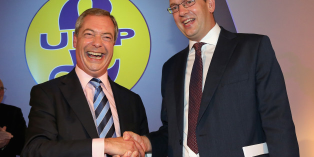 DONCASTER, ENGLAND - SEPTEMBER 27:  Conservative MP Mark Reckless (R) is welcomed to UKIP by party leader Nigel Farage after the tory MP announced he was defecting on the second day of the UKIP (UK Independence Party) party conference at Doncaster Racecourse on September 27, 2014 in Doncaster, England.  Party leader Nigel Farage declared that in the run up to next years general election UKIP will be targeting voters in Conservative and Labour heartlands.  (Photo by Christopher Furlong/Getty Imag