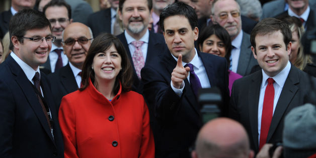 Labour leader Ed Miliband welcomes the newly elected members of parliament to the House of Commons in London, MP for Corby, Andy Sawford (left), MP for Manchester Central, Lucy Powell (second left) and MP for Cardiff South and Penarth, Stephen Doughty (right) after winning their seats in the recent by-elections.