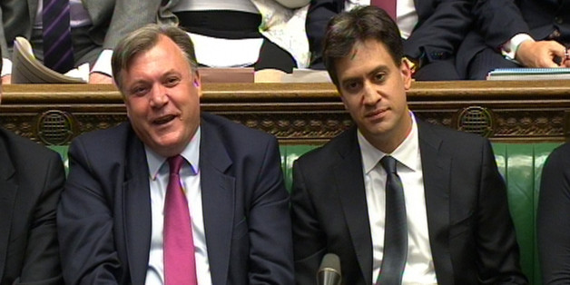 Shadow chancellor Ed Balls and Labour party leader Ed Miliband during Prime Minister's Questions in the House of Commons, London.