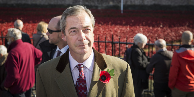 United Kingdom Independence Party (UKIP) leader, Nigel Farage, views the 'Blood Swept Lands and Seas of Red' installation at Tower of London on November 4, 2014 in London, England.  'Blood Swept Lands and Seas of Red' by artist Paul Cummins, made up of 888,246 ceramic poppies fills the moat of the Tower of London, to commemorate the First World War.  Each ceramic poppy represents an allied victim of the First World War and the display is due to be completed by Armistice Day on November 11, 2014.
