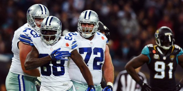 Dallas Cowboys wide receiver Dez Bryant (88) celebrates his touchdown against the Jacksonville Jaguars with guard Zack Martin (70) and center Travis Frederick (72) as defensive end Chris Clemons (91) looks on during the first half of an NFL football game at Wembley Stadium, London, Sunday, Nov. 9, 2014. (AP Photo/Tim Ireland)