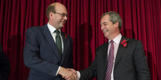ROCHESTER, ENGLAND - NOVEMBER 04:  United Kingdom Independence Party (UKIP) parliamentary candidate Mark Reckless (L) shakes hand with the UKIP leader Nigel Farage (R) at a sold-out public meeting Hoo Village Institute on November 4, 2014 in Rochester, England. Rochester and Strood will hold a by-election on November 20th following the defection of Conservative Party Member of Parliament, Mark Reckless to the United Kingdom Independence Party (UKIP).  (Photo by Rob Stothard/Getty Images)