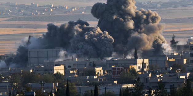 A bombs, seen top left, falls on an Islamic State position in eastern Kobani, during an airstrike by the US led coalition, seen from a hilltop outside Suruc, on the Turkey-Syria border Saturday, Nov. 8, 2014. Kobani, also known as Ayn Arab, and its surrounding areas, has been under assault by extremists of the Islamic State group since mid-September and is being defended by Kurdish fighters. (AP Photo/Vadim Ghirda)