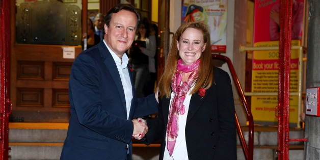 Prime Minister David Cameron with Kelly Tolhurst, the Conservative candidate in the Rochester and Strood by-election, pose for photographs as they leave the Brook Theatre in Chatham, Kent, following a community forum meeting.