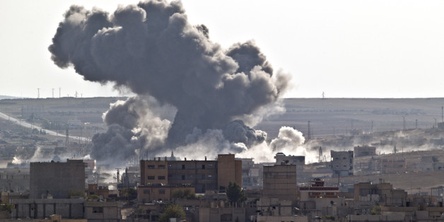 Smoke rises over the Syrian city of Kobani, following a US led coalition airstrike, seen from outside Suruc, on the Turkey-Syria border Monday, Nov. 10, 2014. Kobani, also known as Ayn Arab, and its surrounding areas, has been under assault by extremists of the Islamic State group since mid-September and is being defended by Kurdish fighters. (AP Photo/Vadim Ghirda)