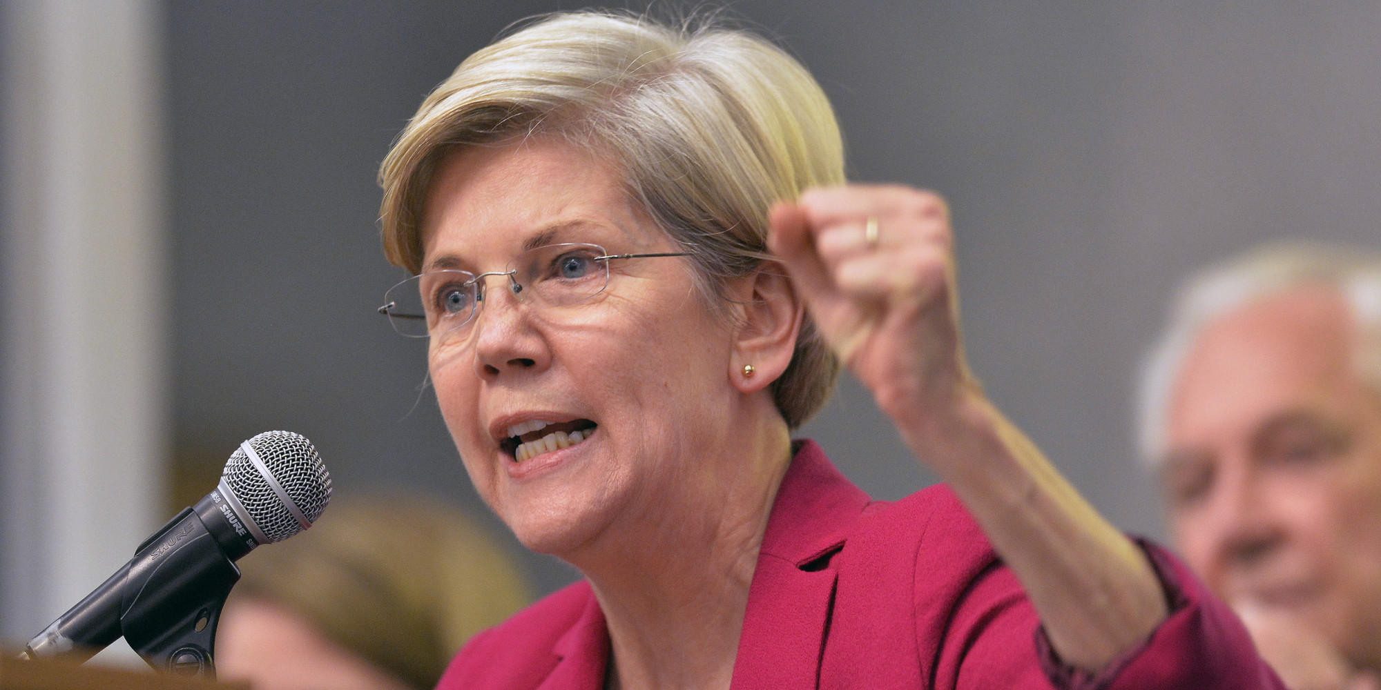 Warren Challenged on Tax Bill Opposition After MA Utility Cuts Rates