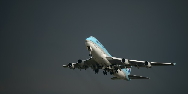 In a photo taken on August 26, 2014 a Korean Air Boeing 747 aircraft takes off before storm clouds at Gimpo airport, south of Seoul. South Korea's international air passenger traffic grew more than 10 percent in July from a year earlier with the number of international air passengers to and from South Korea at 5.13 million, up 10.6 percent from the previous year, according to the Ministry of Land, Infrastructure and Transport. AFP PHOTO / Ed Jones        (Photo credit should read ED JONES/AFP/Ge