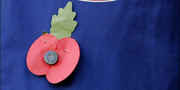 A poppy and the Sunderland club badge