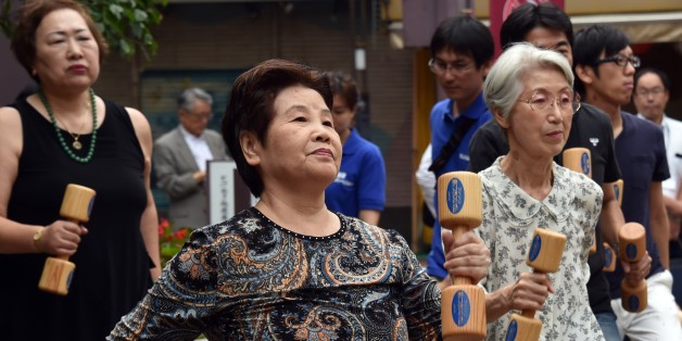 Elderly residents work out with wooden dumb-bells in the grounds of a temple in Tokyo on September 15, 2014 to celebrate Japan's Respect-for-the-Aged-Day.  The number of people aged 65 or older in Japan is at a record 32.96 million, accounting for an all-time high of 25.9 percent of the nation's total population, the government announced.    AFP PHOTO / Yoshikazu TSUNO        (Photo credit should read YOSHIKAZU TSUNO/AFP/Getty Images)
