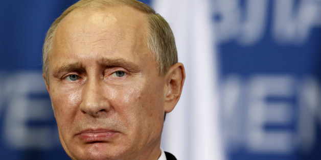 Russian President Vladimir Putin reacts during a press conference after talks with his Serbian counterpart Tomislav Nikolic in Belgrade, Serbia, Thursday, Oct. 16, 2014. Putin arrived on a one-day official visit to Serbia during which he will attend a military parade commemorating 70th anniversary of Belgrades liberation from Nazi occupation. (AP Photo/Darko Vojinovic)