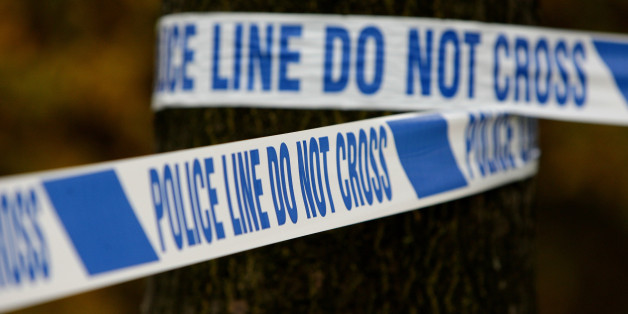 File photo dated 18/11/11 of police tape at a crime scene, as the Office for National Statistics said that there was a 16\% fall in the number of crimes against households and adults in England and Wales in the year to June 2014.