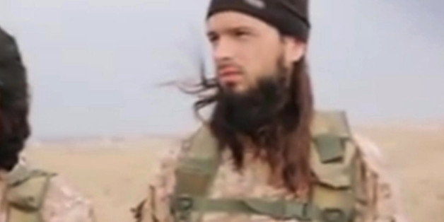 "This still image taken from an undated video published on the Internet by the Islamic State group militants and made available, Sunday, Nov. 16, 2014 shows a militant that the French government say is Frenchman Maxime Hauchard . Interior Minister Bernard Cazeneuve said there is a ""strong presumption"" that Maxime Hauchard is among the group of Islamic extremist fighters in the video released over the weekend. He urged young people in France to ""open your eyes to the terrible reality"" of the milit"