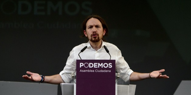 Newly confirmed leader of Podemos, a left-wing party that emerged out of the 'Indignants' movement, Pablo Igesias, gestures during a speech at a party meeting in Madrid on November 15, 2014.  Podemos activists confirmed Pablo Iglesias, 36 years at the head of the movement, in a vote whose results were announced today. Pablo Iglesias was elected secretary general with 88.7% of the vote (95,311 votes out of 107,488) announced the party at a ceremony attended by nearly a thousand people in a Madrid theater.  AFP PHOTO / DANI POZO        (Photo credit should read DANI POZO/AFP/Getty Images)