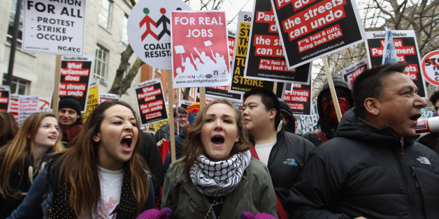 LONDON, UNITED KINGDOM - JANUARY 29 2010:  Student demonstrators march to Parliament to protest against the Government's cuts to public services and an increase in tuition fees on January 29, 2010 in London, England. A simultaneous protest is due to take place in Manchester both will be attended by students, union activists and tax avoidance campaigners.  (Photo by Oli Scarff/Getty Images)