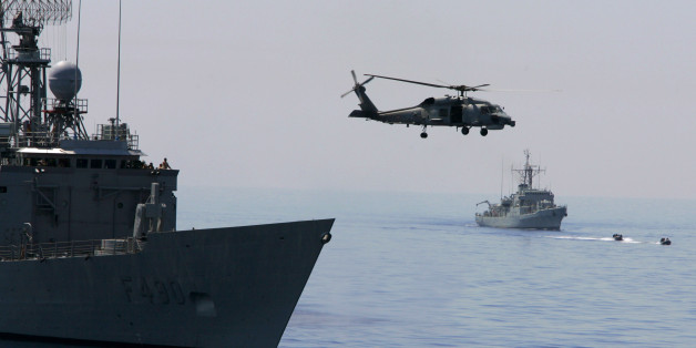 A Turkish Navy Blackhawk helicopter takes off from the Turkish frigate Gaziantep, left, as French Navy destroyer Piquet, right in the background, sets sail during the Anatolian Sun-06 military exercise in the Mediterranean Sea, off the coast of the southern Turkish city of Antalya, Friday, May 26, 2006. In a mock drill, Turkish commandos rappelled from military helicopters onto a merchant ship that intelligence said was carrying weapons of mass destruction, as U.S. commandos raced to join them from a nearby warship. The exercise, with 34 countries participating, was a practice session to prepare for intercepting weapons materials before they reach a country like Iran, Turkey's neighbor. (AP Photo/Murad Sezer)