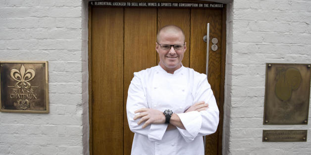 British Chef Heston Blumenthal is pictured at the entrance to the Fat Duck restaurant in Bray, Berkshire, on March 12, 2009. One of the world's finest restaurants, the Fat Duck, is to reopen Thursday, a spokeswoman for British chef Heston Blumenthal told AFP, two weeks after a health scare which hit some 400 diners. The Michelin three starred restaurant in Bray, west of London, closed on February 24 after about 40 customers said they had fallen ill, a figure which rose roughly tenfold following media coverage. AFP PHOTO/Ben Stansall (Photo credit should read BEN STANSALL/AFP/Getty Images)