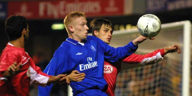 LONDON, UNITED KINGDOM:  Chelsea's Swedish player Mikael Forsell  (C) is sandwiched by two players of Hapoel Tel Aviv players during a second leg UEFA cup match at Stamford Bridge stadium in London, 01 November 2001. The match ended in a 1-1 draw with 3-1 on aggregate in favor of Tel Aviv. AFP PHOTO                 Odd ANDERSEN (Photo credit should read Odd Andersen/AFP/Getty Images)