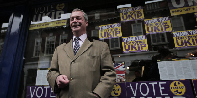 Nigel Farage, the leader of the U.K. Independence Party (UKIP) poses for the photographers in front of the party's offices in Rochester, England, Friday, Nov. 21, 2014, a day after a special election. UKIP, Britain's anti-immigration party, UKIP, has easily won its second seat in parliament as Mark Reckless,  a former Conservative lawmaker ran well ahead of his old party. Reckless, the second Conservative to leave the party and win a seat for UKIP, won 42 percent of the vote in a special election in the Rochester & Strood constituency in southeast England. (AP Photo/Lefteris Pitarakis)