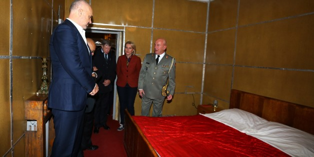 Albanian Prime Minister Edi Rama, left,  looks at the bedroom of late communist dictator Enver Hoxha at a bunker built in Tirana, on Saturday, Nov. 22, 2014. A gigantic, secret underground bunker that Albania's communist regime built in the 1970s to survive a nuclear attack by the Soviet Union or the United States has been opened to the public for the first time. (AP Photo/Hektor Pustina)