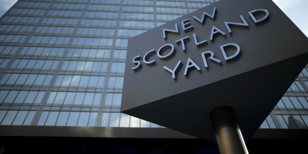 A sign rotates outside New Scotland Yard, the headquarters building of London's Metropolitan Police force in central London, Tuesday, Oct. 30, 2012.  London's police force says it will move from its headquarters at New Scotland Yard as it faces making budget cuts of more than 500 million pounds ($800 million).  Deputy Commissioner Craig Mackey told the mayor's office Tuesday that it plans to save 6.5 million pounds per year by moving to a smaller building.  (AP Photo/Matt Dunham)