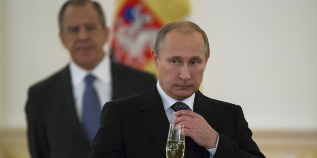 "FILE   In this file photo taken Wednesday, Nov. 19, 2014, Russian President Vladimir Putin prepare to toast with ambassadors in the Alexander Hall after a ceremony of presentation of credentials by foreign ambassadors in the Grand Kremlin Palace in Moscow, Russia. Vladimir Putin says he will not remain Russia's president for life, but will step down in line with the Russian constitution no later than 2024. Staying beyond that would be ""detrimental for the country and I don't need"