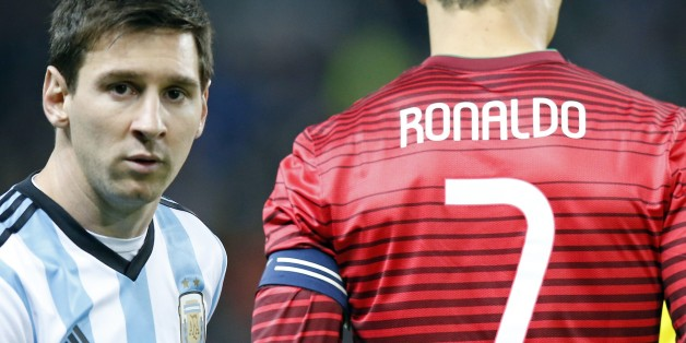 Lionel Messi of Argentina, left, stands next to Cristiano Ronaldo of Portugal before their International Friendly soccer match at Old Trafford Stadium, Manchester, England, Tuesday Nov. 18, 2014. (AP Photo/Jon Super)