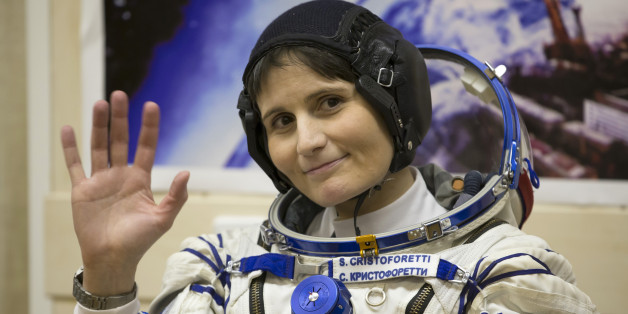 Italian astronaut Samantha Cristoforetti, crew member of the mission to the International Space Station, ISS, waves prior to the launch of Soyuz-FG rocket at the Russian leased Baikonur cosmodrome, Kazakhstan, Sunday, Nov. 23, 2014.  (AP Photo/Dmitry Lovetsky)