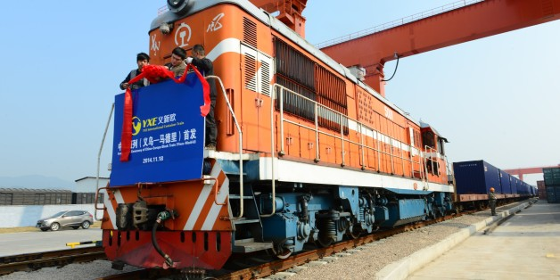 JINHUA, CHINA - NOVEMBER 18:  (CHINA OUT) The inauguration ceremony of China-Europe Block Train (Yiwu-Madrid) at Yiwu Railway Freight Station on November 18, 2014 in Jinhua, Zhejiang province of China. The first China-Europe Block Train carrying 82 containers of exported goods set out for Madrid on Tuesday which meant that the Yiwu-Madrid railway line opened formally. As the longest railway line of China-European lines, the train passes through Kazakhstan, Russia, the Republic of Belarus, Poland