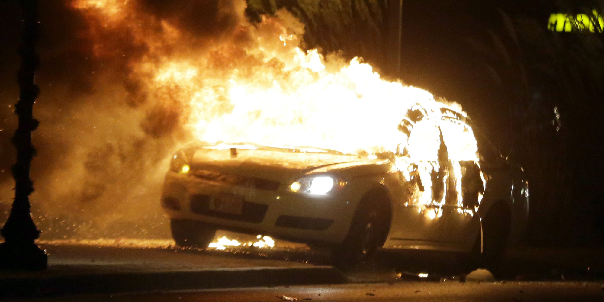 ferguson smolders after night of fires unrest following grand jury